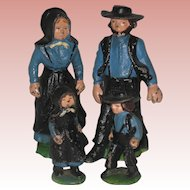 Amish Family - Set of Four Painted Cast Iron Figures