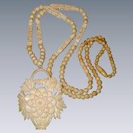 Carved Bone Pendant Necklace with Chrysanthemum Flower Basket Design