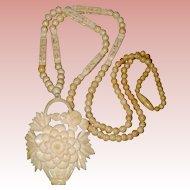 Carved Bone Pendant Necklace with Chrysanthemum Flower Basket Design
