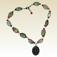 Tibetan Serpentine and Coral Necklace with Bronze Medallion - 16""
