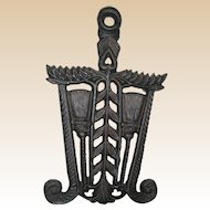 Cast Iron Trivet with Broom Design