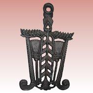 Cast Iron Trivet with Broom Design