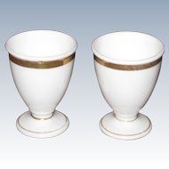 Pair of Elegant White Porcelain Egg Cups with Gold Band