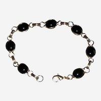 "Black Glass Link Bracelet in Gold-tone Setting - 7 1/2"""