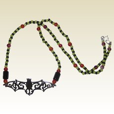 Beaded Bat Necklace in Black, Green and Orange - 19""