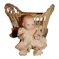 "6"" All Bisque Bye Lo Baby With Wooden Cradle"