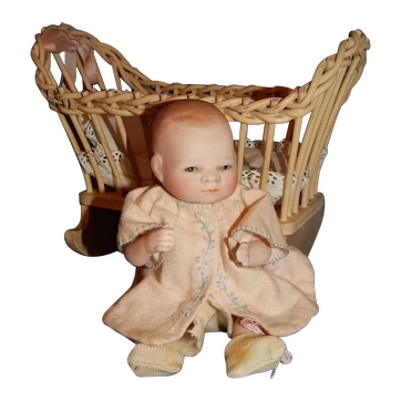"""6"""" All Bisque Bye Lo Baby With Wooden Cradle"""
