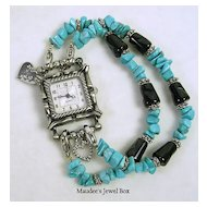 Vintage Simulated Turquoise and Simulated Onyx Silver Tone Charm Bracelet Watch