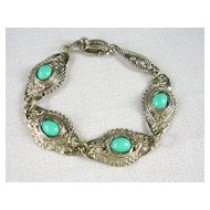 Simulated Turquoise Ornate Link Bracelet in Silver Tone