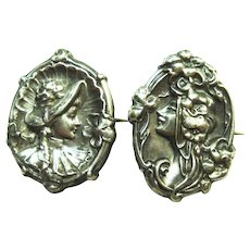 Pair of Art Nouveau Sterling Repousse Lady Pins