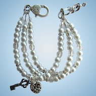 Key to My Heart Three Strand Faux Pearl Bracelet with Aurora Borealis Rhinestones