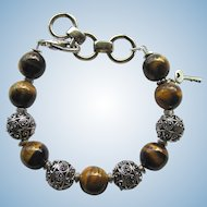 Men's Bracelet of Large Tiger Eye and Metal Cut-Out Beads – Size Large