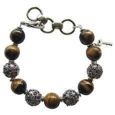 Men's Bracelet of Large Tigereye and Metal Cut-Out Beads – Size Large