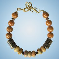 Men's bracelet of Crazy Lace agate and Riverstone in Shades of Caramel and Bronze