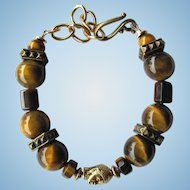 Men's Bracelet of Tigereye Beads and Buddha Focal Bead with Brass Accents