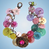 Charm Bracelet of Vintage Buttons in Pastel Shades with Filigreed Button Focal