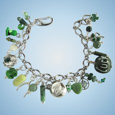 Charm Bracelet with Lucky Charms – Leprechaun's hat – Dragon – Wishbone – Celtic Harp – Shamrocks