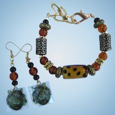Bracelet of Textured Beads and Lampwork Focal – Cheetah Earrings