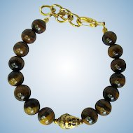 Men's Bracelet of Tiger's Eye Beads with Buddha Focal Bead