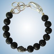 Men's Bracelet of Black Lava Beads with Buddha Focal Bead