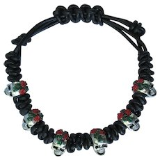 Bracelet of Black Leather and Skulls with Red Roses