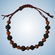 Bracelet with Carved Horn and Bone Beads in Shades of Amber and Sienna