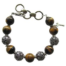 Men's Bracelet of Large Tiger Eye Beads with Metal Cut-Out Bead Accents
