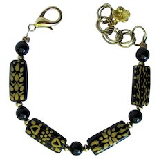 Bracelet of Black Ceramic Beads Hand-Painted with Gold Designs