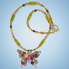 Butterfly Pendant on Necklace of Yellow Flower Beads and Swarovski Crystals