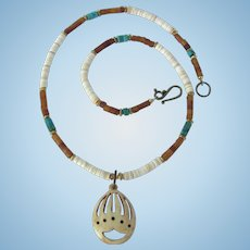 Bear Paw Pendant on Necklace of Horn and Melon Shell Heishis with Turquoise Accents