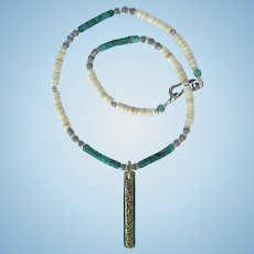 Tibetan Amulet Pendant on Necklace of Nacozari Turquoise and Melon Shell Heishis