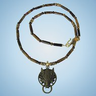 Wolf Pendant in Bronze on Necklace of Tiger Eye in Tawny Shades