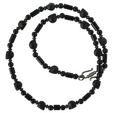 Men's Necklace in Black with Magnesite Skulls and Black Onyx Beads