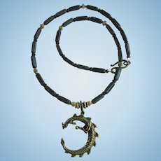 Brass Dragon Pendant on Necklace of Dark Grey Tube Beads