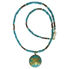 Turquoise and Brass Tibetan Endless Knot Pendant on Long Turquoise Necklace