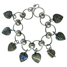 Puffy Heart Charm Bracelet with Eight 1940s and Victorian Sterling Silver Hearts