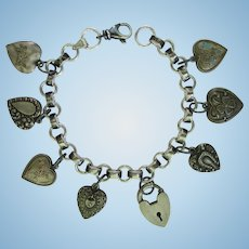 Charm Bracelet with Eight Sterling Silver Puffy Hearts – Victorian and 1940s