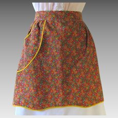 Vintage Apron in Calico of Orange and Yellow against Green Background