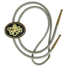 Bolo Tie with Black and Off-White Octopus in Antiqued Bezel on Grey Cord