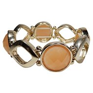 Melon Colored Faceted Plastic Stone and Goldtone Stretch or Expansion Bracelet