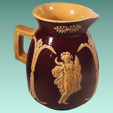 Brown Glaze Majolica Pate Sur Pate Pitcher Classical Figures and Columns in Relief