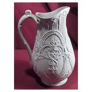 Early Relief Molded Salt Glaze Pitcher with Beading and Scrolls