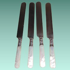 Set of Four Sterling and Mother of Pearl Dinner Knives
