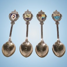 Set of Four Early Canadian Sterling Silver and Enamel Souvenir Spoons
