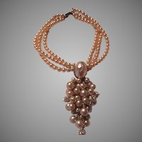 Triple Strand Faux Pearls With Center Cascade