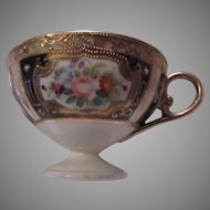 Porcelain Footed Cup Ornate Flowers Shiny Gold