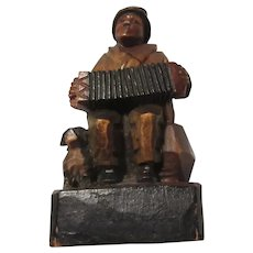 Carved Small Man Playing Accordion