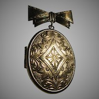 Large Gold Tone Metal Locket On Bow Pin