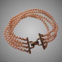 Richelieu Signed Four Strand Faux Pearls Bracelet