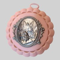 Guardian Angel With Children Medal On Pink Plastic